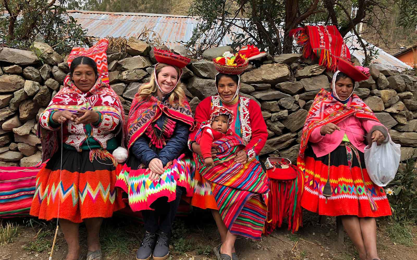 woman learning traditional peruvian garment weaving