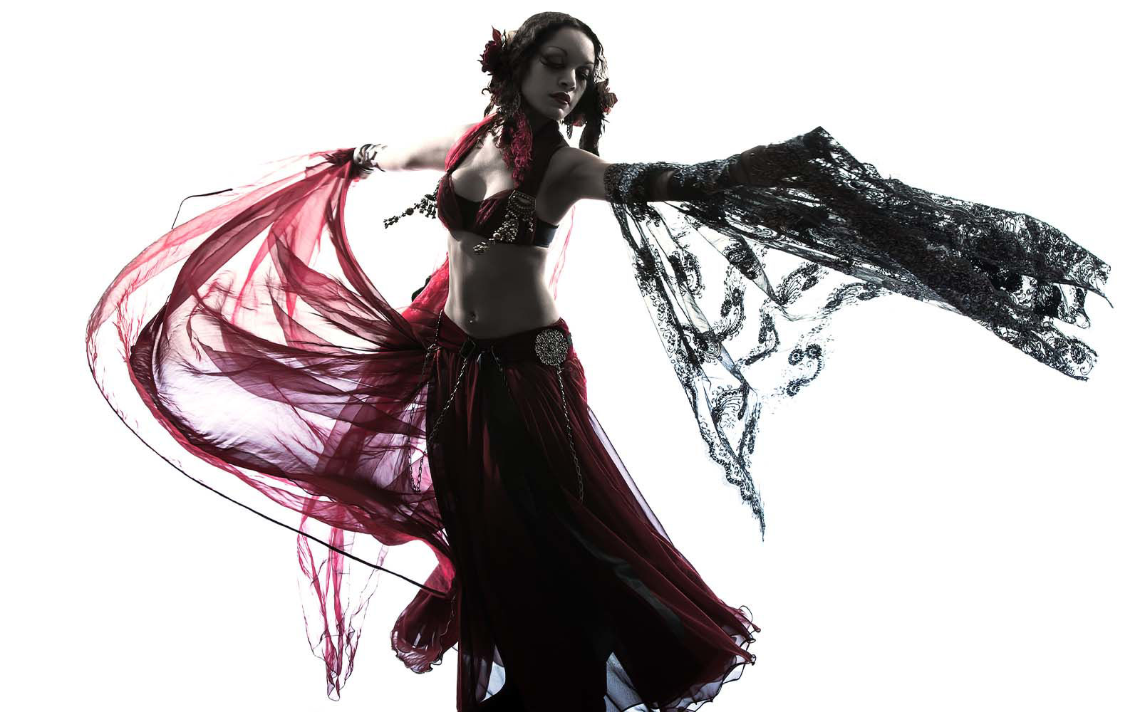 woman in traditional belly dance garb dancing