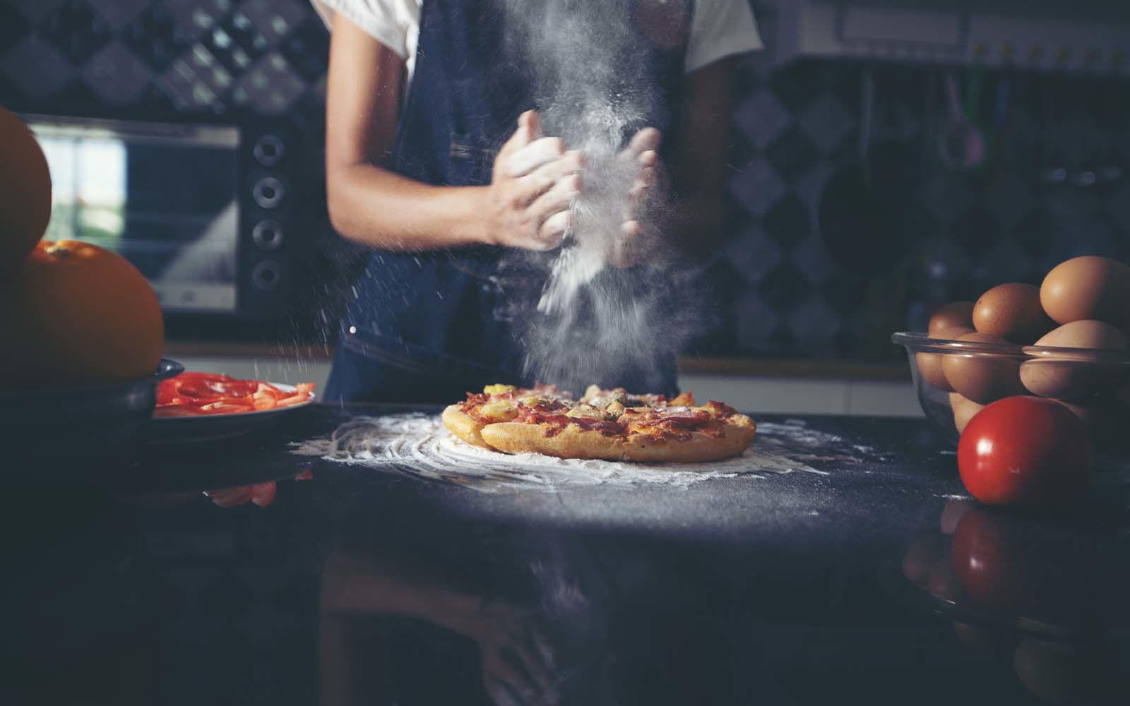 chefs hands dusting off flour