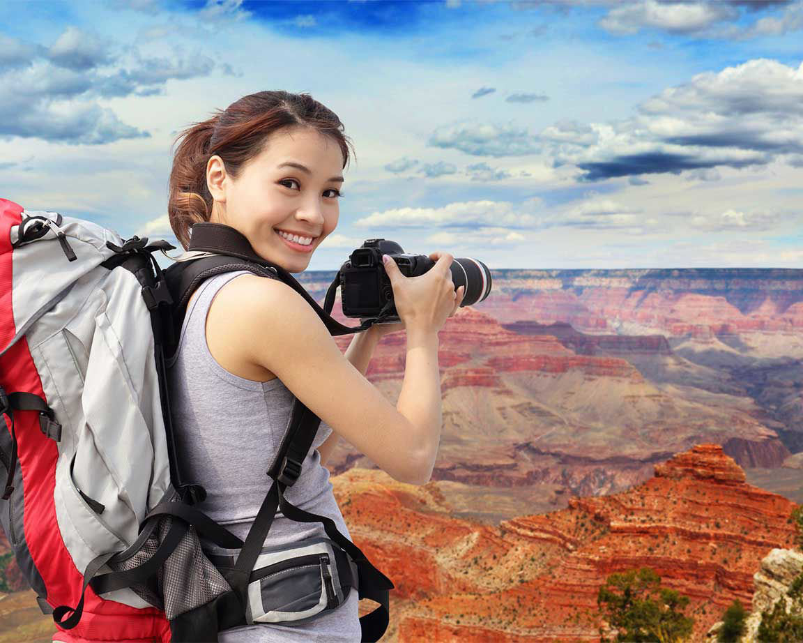 woman overlooking geological formations of the southerwestern united states