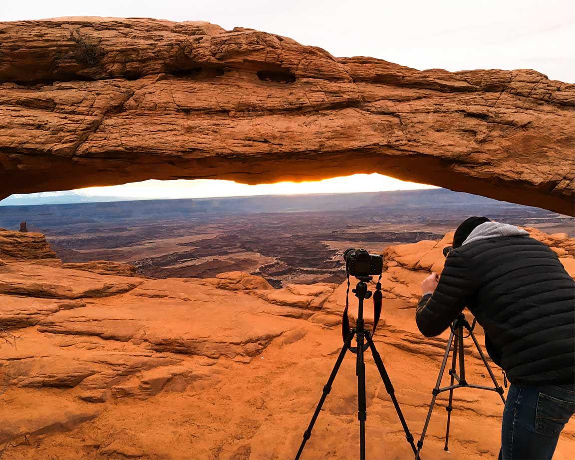 photographer taking photo of southwest canyonlands